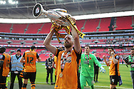 David Meyler of Hull City lifts the Sky Bet Championship Playoff Trophy.Skybet football league Championship play off final match, Hull city v Sheffield Wednesday at Wembley Stadium in London on Saturday 28th May 2016.<br /> pic by John Patrick Fletcher, Andrew Orchard sports photography.