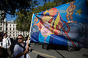 Protesters with a devil Boris Johnson banner outside The Supreme Court as the first day of the hearing to rule on the legality of suspending or proroguing Parliament begins on September 17th 2019 in London, United Kingdom. The ruling will be made by 11 judges in the coming days to determine if the action of Prime Minister Boris Johnson to suspend parliament and his advice to do so given to the Queen was unlawful. (photo by Mike Kemp/In Pictures via Getty Images)