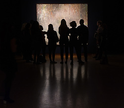 Christie's, London, March 3rd 2017. PICTURED: Gallery visitors admire Peter Doig's 'Cobourg 3 + 1 More' which is expected to fetch between £8--12 million. <br /> Fine art auctioneers Christies hold a press preview for their Post-War and Contemporary Art auctions to be held on March 7th and 8th.