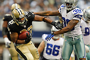 Dallas Cowboys cornerback Brandon Carr (39) pushes New Orleans Saints running back Pierre Thomas (23) to the ground at Cowboys Stadium in Arlington, Texas, on December 23, 2012.  (Stan Olszewski/The Dallas Morning News)