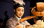 Zhang Lin, 23 leading Yue opera performer from the Xiao Bai Hua Shaoxing Opera Troupe during a performance in a rural village close to Shaoxing City, Zhe Jiang province, China.                                She is one of the leading ights of Yue opera which as a form was born as late as the 1930's and she's been part of this troupe since she was 14. Today Yue opera like all traditional art forms faces stiff competition from television and all sorts of other entertainment and  as the troupe  no longer receive significant state funding, they must perform at least 150 times a year travelling far and wide across the country