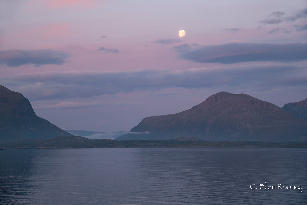 Sunrise and moonset on the northwest coast of Norway north of Kristiansund during a cruise on a Hurtigruten ship.  Norway