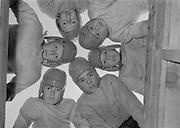 0003-006. Football huddle. Elementary school team, Evaline school, near Winlock, Washington. The photographer, Stuart Fresk, was a teacher there from 1935 to 1946.