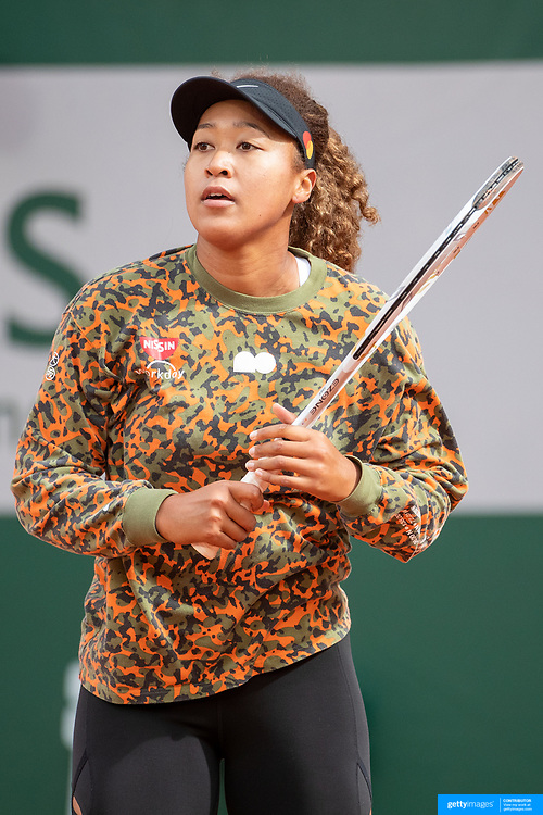PARIS, FRANCE May 26. Naomi Osaka of Japan practicing on Court Philippe-Chatrier during a practice match against Ashleigh Barty of Australia  in preparation for the 2021 French Open Tennis Tournament at Roland Garros on May 2pm 6th 2021 in Paris, France. (Photo by Tim Clayton/Corbis via Getty Images)