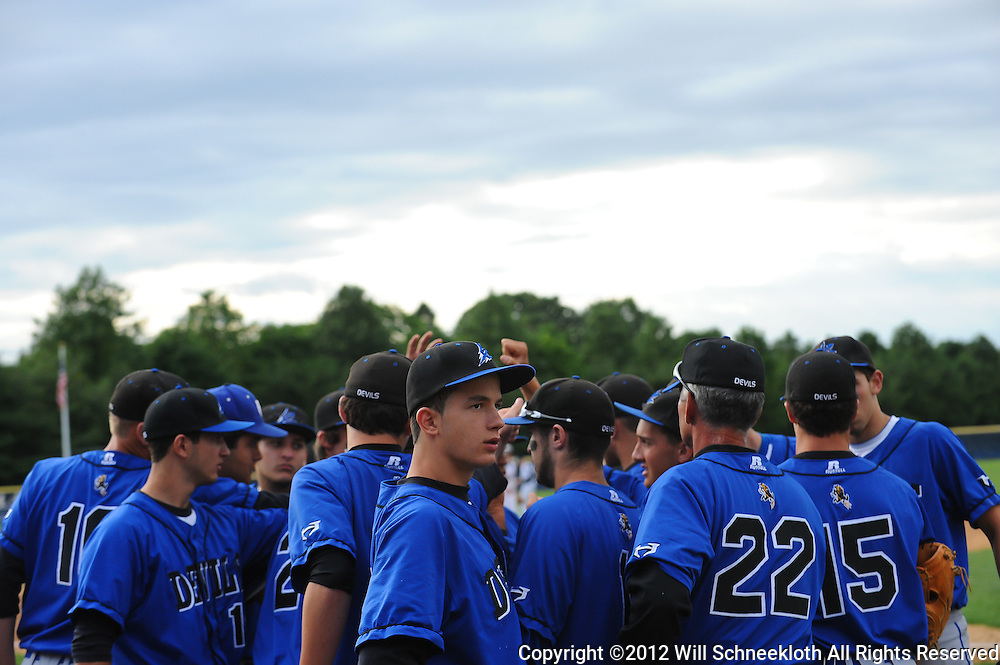 Hammonton High School huddles between innings of NJSIAA Group III baseball semifinal action between Hammonton High School and Freehold Boro High School at Monmouth University..Photo/Will Schneekloth special to The Daily Journal