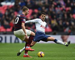 Newcastle United's Florian Lejeune and Tottenham Hotspur's Erik Lamela battle for the ball