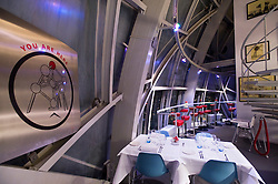 BRUSSELS, BELGIUM - FEB-4-2008 - The Atomium Restaurant is located in the top sphere of the Atomium, and provides a panoramic view of Brussels. The Atomium is a monument built for Expo '58, the 1958 Brussels World's Fair. Designed by André Waterkeyn, it is 103-metre (335-feet) tall, with nine steel spheres, each 18 meters in diameter, connected so that the whole forms the shape of a unit cell of an iron crystal magnified 165 billion times. Tubes which connect the spheres along the 12 edges of the cube and from all eight vertices to the centre; these tubes enclose escalators containing exhibit halls and other public spaces. (PHOTO © JOCK FISTICK)
