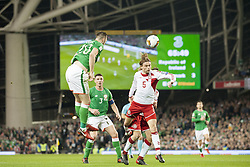 November 14, 2017 - Dublin, Ireland - Shane Duffy of Ireland jumps for the ball with Peter Ankersen of Denmark during the FIFA World Cup 2018 Play-Off match between Republic of Ireland and Denmark at Aviva Stadium in Dublin, Ireland on November 14, 2017 Denmark defeats Ireland 5:1. (Credit Image: © Andrew Surma/NurPhoto via ZUMA Press)