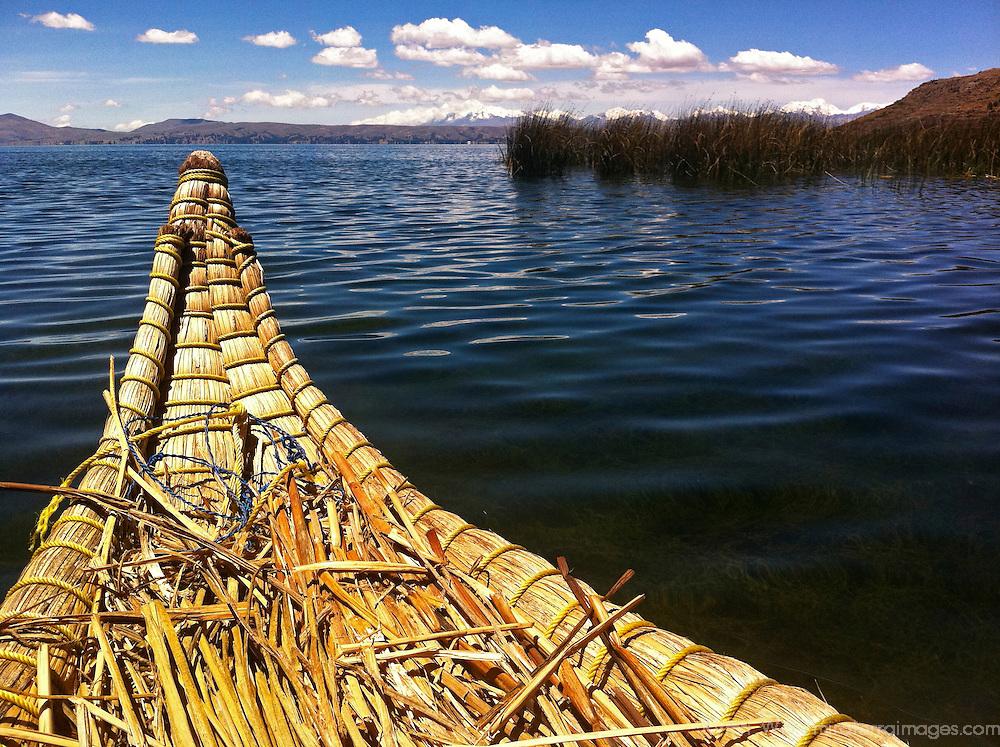 South America, Peru, Lake Titicaca. Reed boat of Uros floating islands on Lake Titicaca.