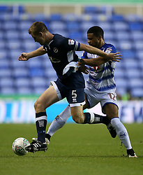 Millwall's Tony Craig and Reading's Garath McCleary battle for the ball