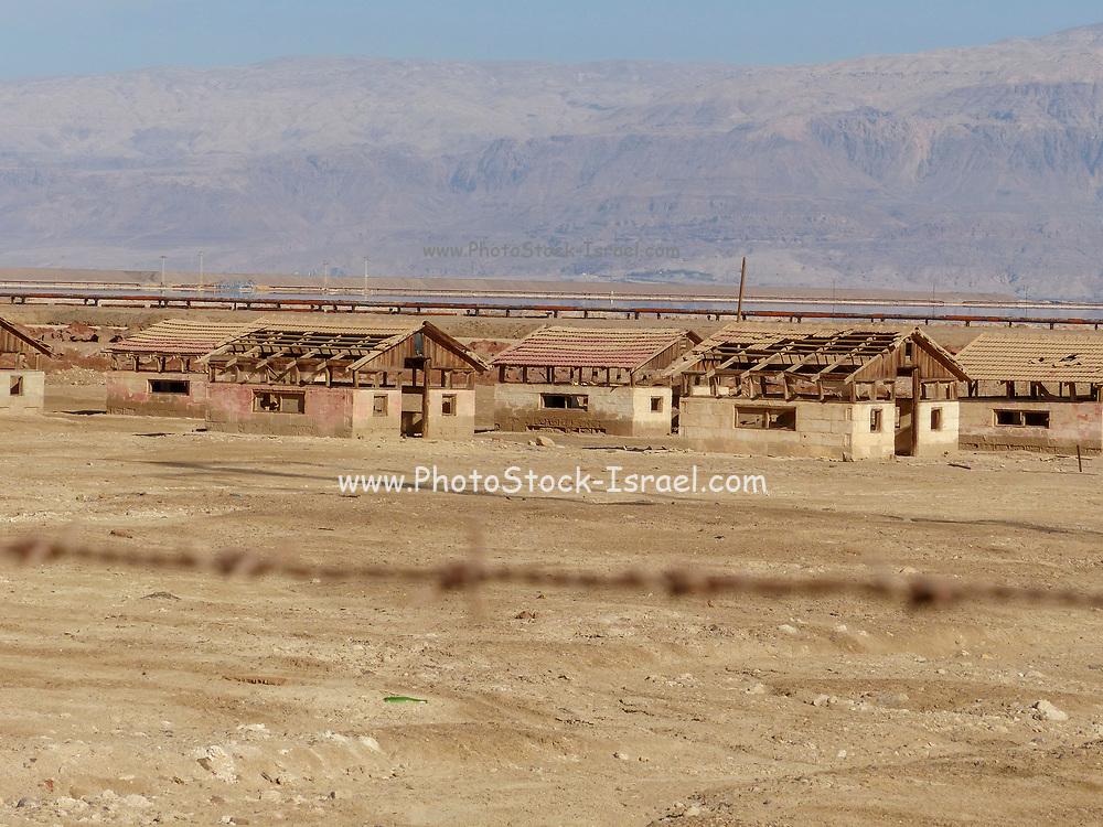 Israel, Dead Sea. Abandoned barracks buildings on the shore