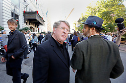 20 November 2015. Orpheum Theater, New Orleans, Louisiana. <br /> Memorial service for musician Allen Toussaint. <br /> Quint Davis at the second line parade following the service.<br /> Photo; Charlie Varley/varleypix.com