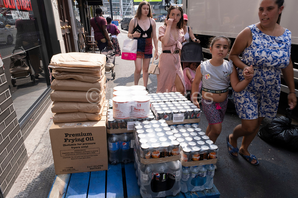 Fizzy drinks piled up on the pavement for delivery to a local shop on 12th August 2020 in London, United Kingdom. The UK sugar tax,<br /> officially called the Soft Drinks Industry Levy SDIL, the tax puts a charge of 24p on drinks containing 8g of sugar per 100ml and 18p a litre on those with 5-8g of sugar per 100ml, directly payable by manufacturers to HM Revenue and Customs.