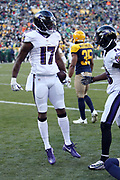 Baltimore Ravens wide receiver Mike Wallace (17) leaps in the air in celebration after catching a 21 yard third quarter touchdown pass that gives the Ravens a 13-0 lead while covered by Green Bay Packers cornerback Damarious Randall (23) during the 2017 NFL week 11 regular season football game against the against the Green Bay Packers, Sunday, Nov. 19, 2017 in Green Bay, Wis. The Ravens won the game in a 23-0 shutout. (©Paul Anthony Spinelli)