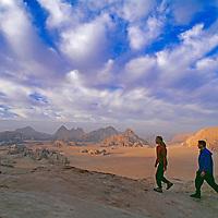 Hiker ascend an ancient Bedouin route on Jebel [Mount] Burdah.  Jordan's Wadi Rum. (MR)