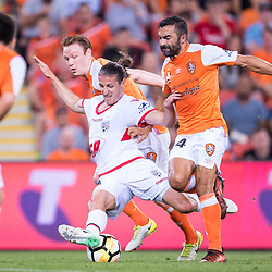 BRISBANE, AUSTRALIA - OCTOBER 13: Michael Marrone of Adelaide is tackled by Corey Brown and Fahid Ben Khalfallah of the Roar ball during the Round 2 Hyundai A-League match between Brisbane Roar and Adelaide United on October 13, 2017 in Brisbane, Australia. (Photo by Patrick Kearney)