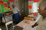 Doug Brown visits his butcher in Ipswich, Australia (near Brisbane) to purchase one weeks' worth of meat for his family's upcoming photo shoot. Normally Doug would buy enough for two weeks since he gets a fortnightly government disability check. (Supporting image from the project Hungry Planet: What the World Eats.)