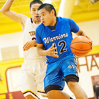 022813  Adron Gardner/Independent<br /> <br /> Navajo Pine Warrior Kevin Bia (12) drives baseline past Tohatchi Cougar Marcus Burbank (34) in Tohatchi Thursday.