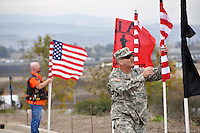 Early Tuesday morning, veterans from American Legion Riders District 28 and other volunteers unfurl flags along the approach road to the Monterey County Vietnam Veterans Memorial on East Laurel in Salinas. There are 78 flags in all, one for each name on the memorial's wall.
