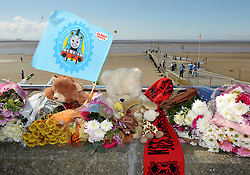© Licensed to London News Pictures. 20/08/2012. Burnham-on-Sea, Somerset, UK.  Flowers are left on the seafront near the jetty where a 4 year old boy fell off the jetty into the sea on Sunday night.  Emergency services are now working on the basis of recovering a body. The area has one of the highest tidal ranges in the world with strong currents especially around the jetty.  20 August 2012..Photo credit: Simon Chapman/LNP
