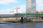 Loopline rail bridge or Liffey viaduct spanning river from Pearse railway station, Dublin, Ireland, built 1891 designed by John Chaloner Smith