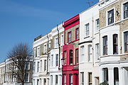 Bright and colourful house facades in Lancaster Road, near Portobello Road, on the 26th March 2018 in Notting Hill, United Kingdom.