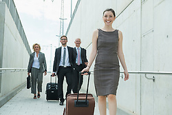 four colleagues on business travel