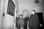 """26/03/1966<br /> 03/26/1966<br /> 26 March 1966<br /> President receives Banna Strand Memorial Committee at Aras an Uachtarain. Officials of the combined committees of the Roger Casement Association, the Banna Strand Memorial Committee and the Limerick Roger Casement Association, met in Dublin and discussed with President Eamon de Valera about arrangements for the Roger Casement Commemoration Ceremonies to be held at Banna Strand, Co. Kerry, on Good Friday.<br /> Picture shows the President showing the Committee the painting by Sir John Lavery, R.A., R.H.A., of the """"Trial of Roger Casement in London 1916"""", hanging in the reception hall at Aras an Uachtarain. Included are (l-r): Sean S. O Conchubhair, Secretary/Treasurer, National Executive, Banna Strand Memorial Committee; Mrs Mary McInerney-Spillane, P.C., Assistant Treasurer, Limerick Roger Casement Association; Dr Herbert Mackey, Dun Laoghaire, President, Dublin Roger Casement Association; Mr Tadhg Smalle, P.C., Chairman, Limerick Roger Casement Association and Mr Eamonn O Mathuna, Chairman, National Executive, Banna Strand memorial Committee."""