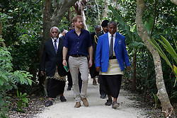 The Duke of Sussex walks through the forest during a visit to Tupou College in Tonga as they visit Tupou College on the second day of the royal couple's visit to Tonga.