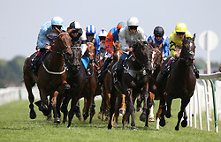 Runners approach an early bend in The JLT Cup run during Weatherbys Super Sprint Day at Newbury Racecourse, Newbury.