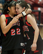 Kalleen Shutiva consoles teammate Julie Gallegos after Kirtland Central defeated Grants 53-49 in the AAAA semifinals Thursday afternoon in Albuquerque at The Pit.