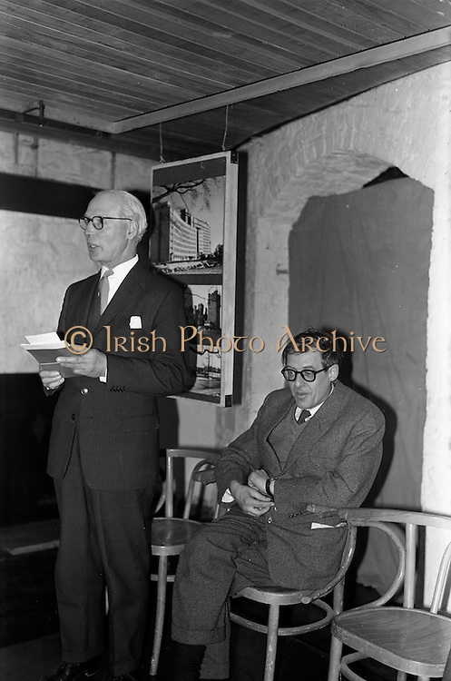 """05/04/1963<br /> 04/05/1963<br /> 05 April 1963<br /> Opening of """"Ulster Today"""" architectural photographic exhibition.Organised by the Royal Society of Ulster Architects opened at the Gallery of the Building Centre of Ireland  in Dublin in the presence of Donagh O'Malley, Parlimentary Secretary to the Minister for Finance and Sir Ian MacLennan, British Ambassador to Ireland. The exhibition was later displayed in Belfast. Picture shows: President of the Royal Society of Ulster Architects, Charles Munro ARIBA (left) speaking at the opening. Also in the picture is Dr. R.B. McDowell, Trinity College, Dublin, who officially opened the exhibition."""