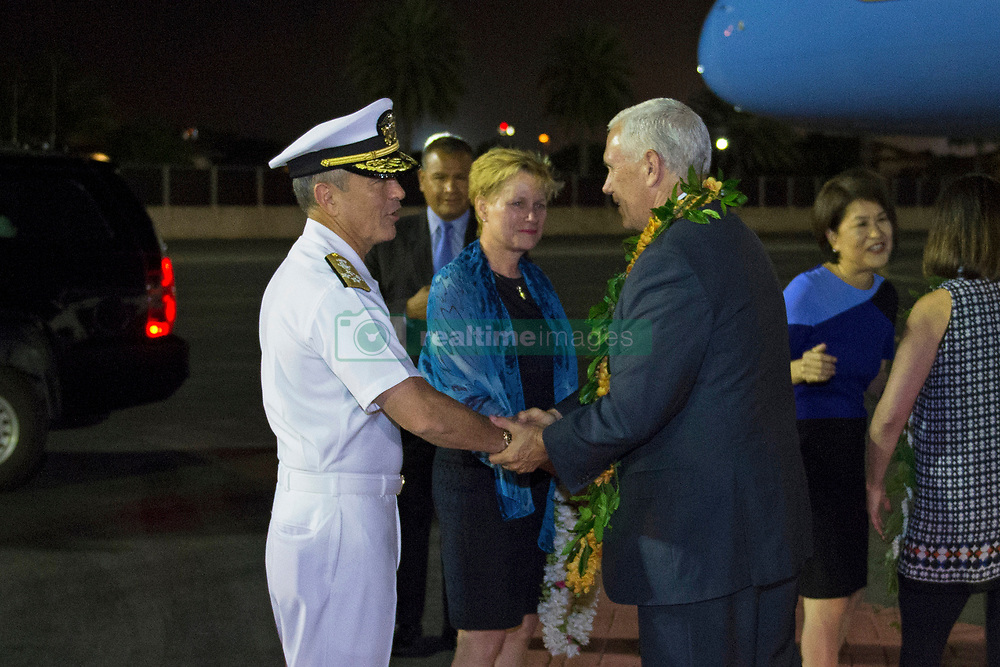 170424-N-WY954-007 JOINT BASE PEARL HARBOR-HICKAM, Hawaii (April 23, 2017) – Adm. Harry B. Harris Jr., Commander, United States Pacific Command (USPACOM), greets Vice President Mike Pence upon his arrival at Hickam Airfield.  Pence's stop in Hawaii caps off his first official visit to the Indo-Asia-Pacific region reinforcing the United States' full commitment to its security alliances. (U.S. Navy photo by Mass Communication Specialist 2nd Class Robin W. Peak/Released)