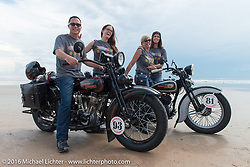 Licenced Harley-Davidson artist Scott Jacobs on his 1926 Harley-Davidson JD and his wife Sharon Jacobs on her 1936 Harley-Davidson VLH with their daughters Olivia and Alexis on the sands of Daytona Beach before the start of stage 1 of the Motorcycle Cannonball Cross-Country Endurance Run, which on this day ran from Daytona Beach to Lake City, FL., USA. Friday, September 5, 2014.  Photography ©2014 Michael Lichter.