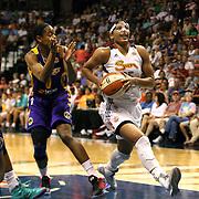Alyssa Thomas, (right), Connecticut Sun, drives to the basket past Alana Beard. Los Angeles Sparks, during the Connecticut Sun Vs Los Angeles Sparks WNBA regular season game at Mohegan Sun Arena, Uncasville, Connecticut, USA. 3rd July 2014. Photo Tim Clayton