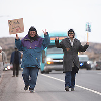 Virgina Lee of Chine, left, and Kelli Arthur of Window Rock  walk down Montoya Boulevard to the Larry Brian Mitchell Recreation Center for a tribute to Martin Luther King, Jr. Monday afternoon in Gallup.