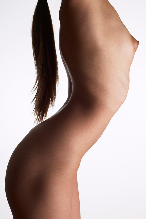 Profile of nude woman's torso with pony tail hanging down her back