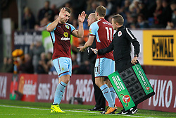 Burnley's Sam Vokes (left) comes off for Burnley's Chris Wood during the Carabao Cup, third round match at Turf Moor, Burnley.