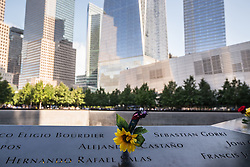 September 11, 2016 - New York, NY, United States - Flowers adorn the names of the fallen victims of the September 11, 2001 terrorist attacks. During the formal ceremony at Ground Zero to commemorate the 15th anniversary of the September 11th terrorist attacks on the World Trade Center, the Pentagon and the crash of United Airlines Flight 93 in Shanksville, PA; relatives of the victims commemorated placed flowers on the registry of names constructed around the sites reflecting pools and uniformed FDNY firefighters held a separate commemoration of their fallen colleagues. (Credit Image: © Albin Lohr-Jones/Pacific Press via ZUMA Wire)