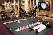 Houston, Texas - February 19, 2016: Royce Gracie lays on the mat backstage while Kimbo Slice visits with his corner before their fights during Bellator 149 at the Toyota Center in Houston, Texas on February 19, 2016. (Cooper Neill for ESPN)