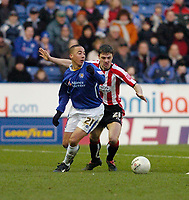 Photo: Leigh Quinnell.<br /> Leicester City v Southampton. The FA Cup. 28/01/2006.<br /> Leicesters Ryan Smith can't find a way past Southamptons Chris Baird.