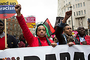 Black Activists Rising Against Cuts demonstrators protest with their fists raised at Anti-racism Day demonstration led by Stand Up To Racism on 19th March 2016 in London, United Kingdom. Stand Up To Racism has led some of the biggest anti-racist mobilisations in Britain of the last decade, making a stand protesting against racism, Islamophobia, anti-Semitism and fascism.