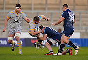 Sale Sharks No.8 Dan Du Preez tackles Wasps flanker Thomas Young during the Gallagher Premiership Rugby match Sale Sharks -V- Wasps  at The AJ Bell Stadium, Greater Manchester, England United Kingdom, Sunday, December 27, 2020. (Steve Flynn/Image of Sport)