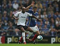 Photo: Lee Earle.<br /> Portsmouth v Bolton Wanderers. The FA Barclays Premiership. 18/08/2007.Bolton's Nicolas Anelka (L) battles with Hermann Hreidarsson.
