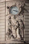 The ornate reliefs credited to Villeneuvo and clockface seen on the exterior of the Caisse DEpargne bank on Boulevard Ledru Rollin on 19th June 2016, in Montpellier, France.
