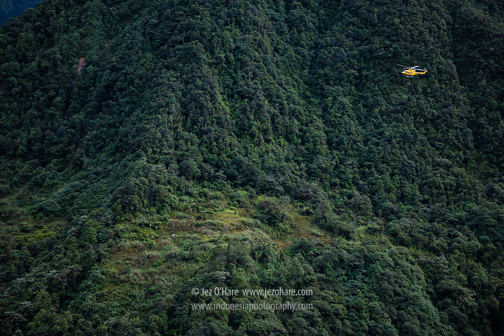 PT Freeport Bell 412 helicopter sling load operation near Tembagapura, Mimika, Papua, Indonesia.