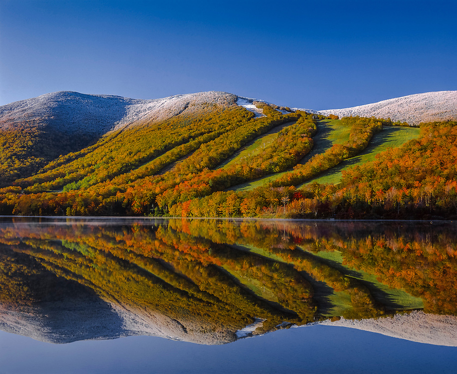 Frost-topped Cannon Mountain ski area, fall foliage & reflections in Echo Lake, Franconia Notch State Park, NH