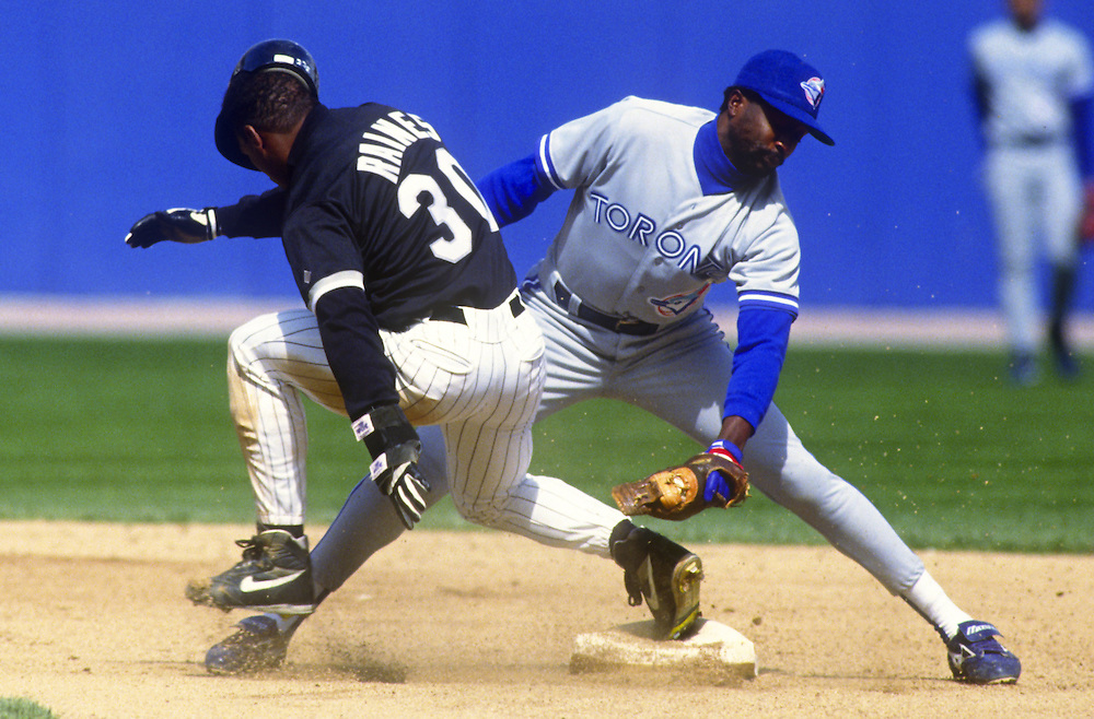 CHICAGO - 1993:  Tim Raines of the Chicago White Sox steals second base under the tag of Alfredo Griffin of the Toronto Blue Jays during the American League Championship Series at Comiskey Park in Chicago, Illinois.  Raines played for the White Sox from 1991-1995.(Photo by Ron Vesely)