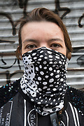 "March, 17th, 2020 - Paris, Ile-de-France, France: Parisians wearing a range of masks and facial coverings in the hope of protecting themselves from the spread of the Coronavirus, during the first day of near total lockdown imposed in France. The day before President of France, Emmanuel Macron, said the citizens must stay at home from midday on Tuesday for at least 15 days. He said ""We are at war, a public health war, certainly but we are at war, against an invisible and elusive enemy"". All journeys outside the home unless justified for essential professional or health reasons are outlawed. Anyone flouting the new regulations would be punished. Nigel Dickinson"
