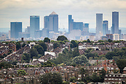 London, United Kingdom, July 27, 2021: A general picture looking at south London from Alexandra Palace, North London shows skyscrapers at the Canary Wharf financial district of the capital London on Tuesday, July 27, 2021. (VX Photo/ Vudi Xhymshiti)